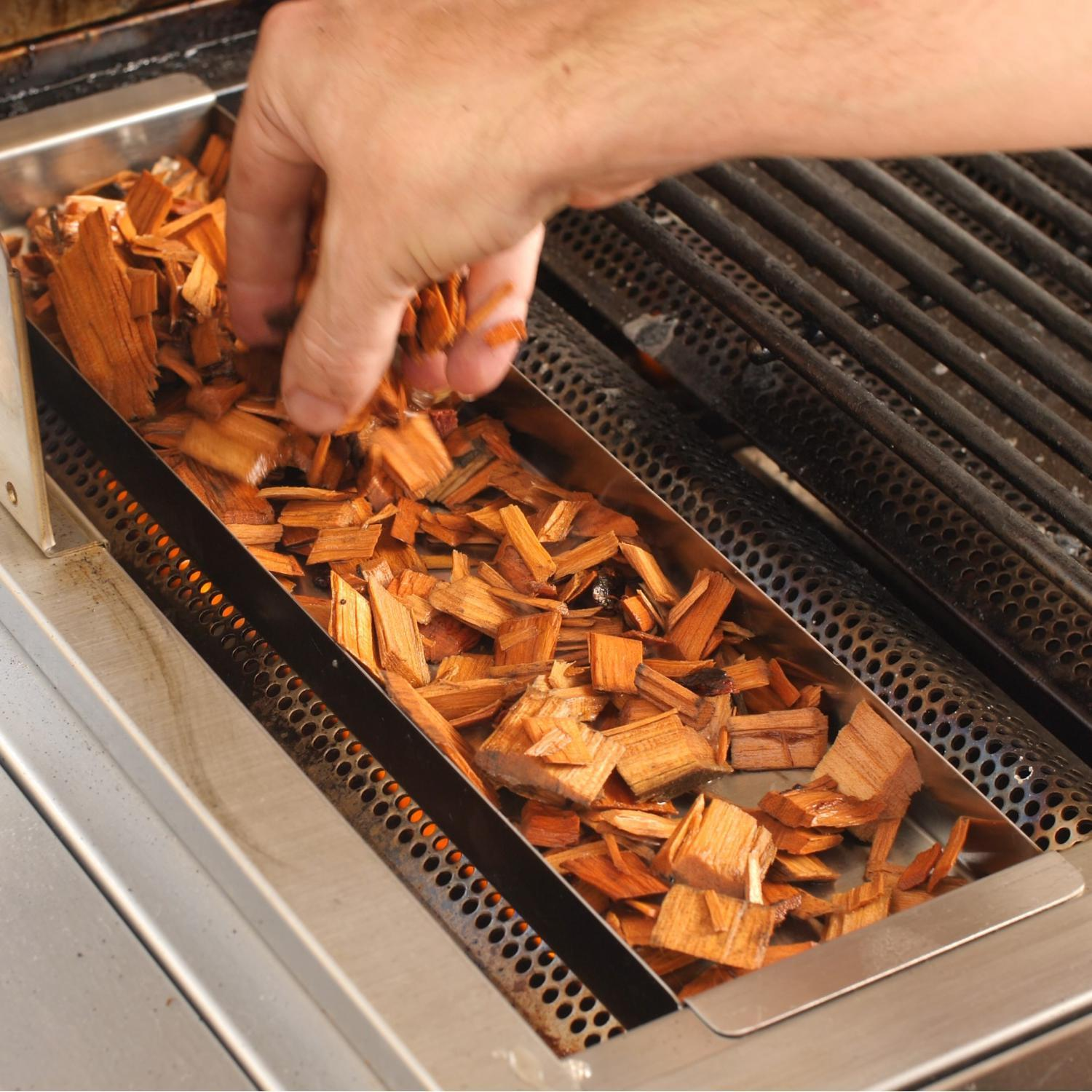 Smoker box on outdoor stainless steel grill