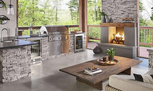 Outdoor Kitchen with Fireplace and Furniture