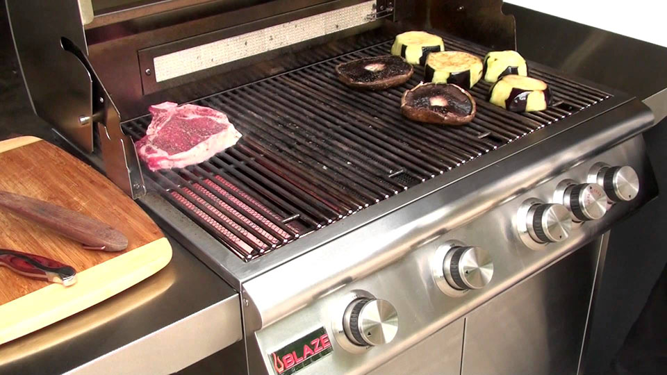Steak searing on infrared burner on outdoor stainless steel grill